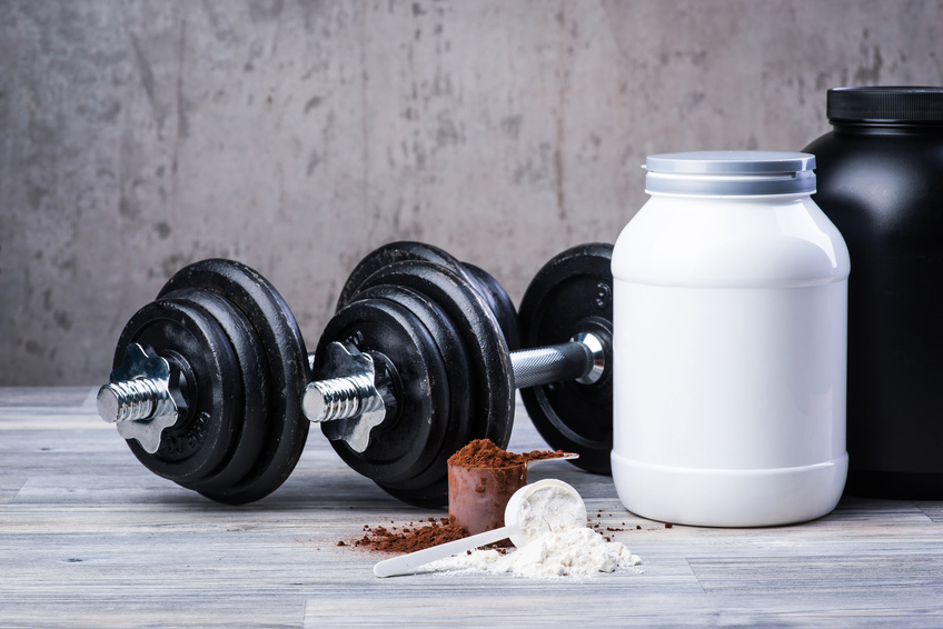 Classic black dumbbells with protein jars